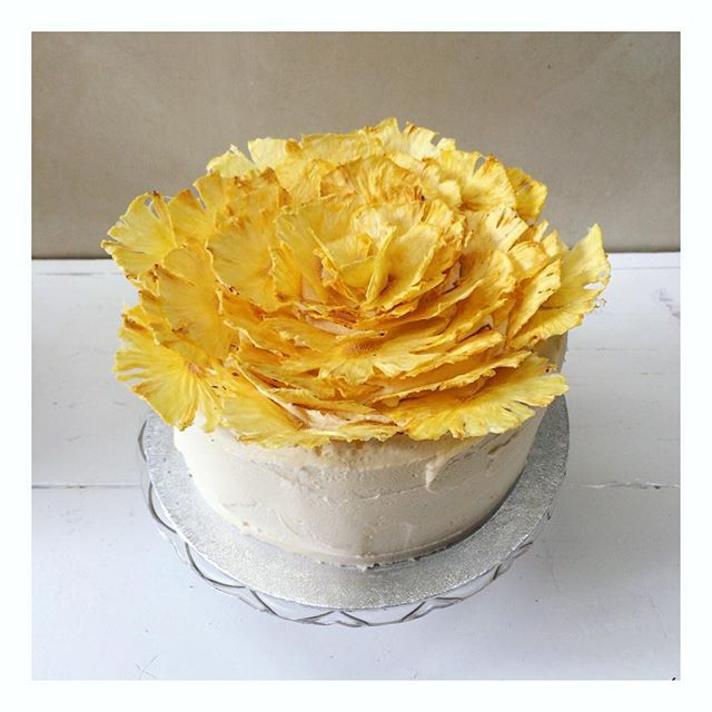 This pineapple cake is finished with a dehydrated pineapple flower, each petal arranged by hand