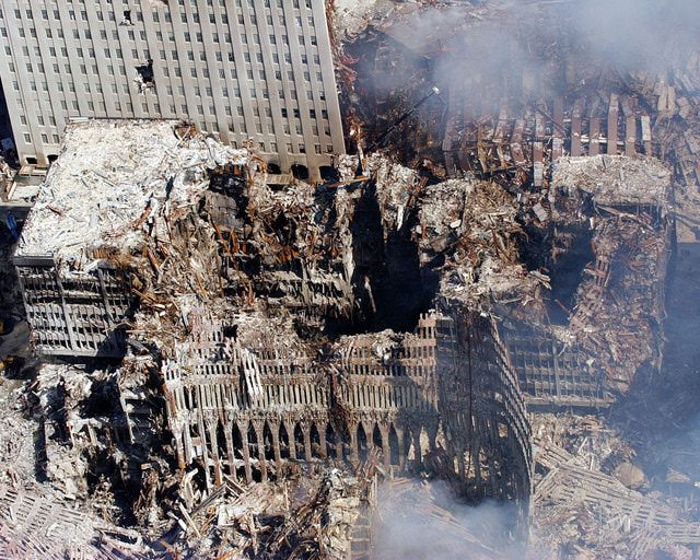 9-11 Photos: Attack on the World Trade Center. Aerial view of the World Trade Center ruins, five days after the terrorist attack in New York City.