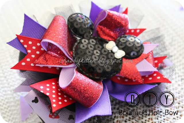 DIY Boutique Hair bow. I know an almost 4 year old who would love this. And someone who happens to make great bows. :)