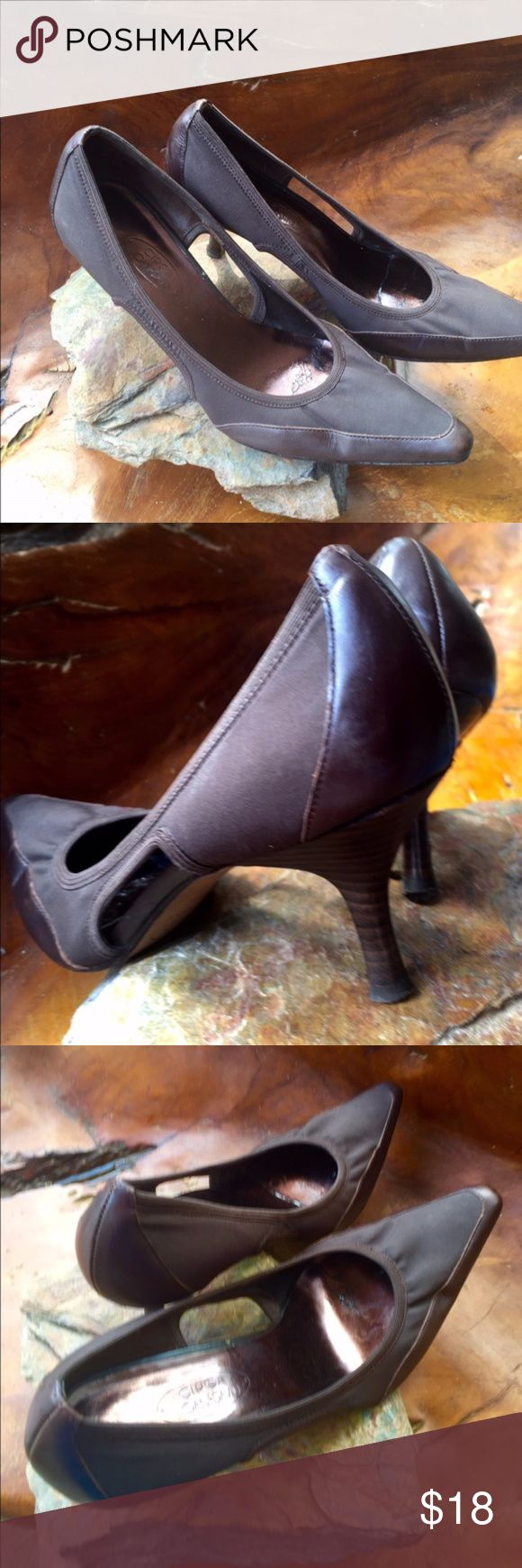 Circa Joan & David Brown Pumps ~Size 8 1/2 These brown Circa Joan & David Pumps have a pointed toe and a 2.75 stacked wood heel. The great thing about these awesome Pumps is the fact that the uppers are made of a stretchy type material. These shoes are classy and sophisticated with the cut outs on each side of the foot. There is a band of elastic around the top. There is some signs of wear on the sole of the shoe but no issues effecting the appearance. The bottom is stamped Circa Joan…