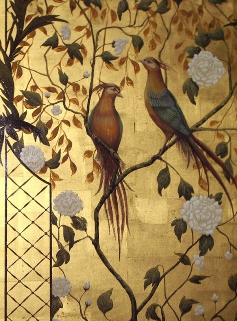 Beautiful gold metallic wallpaper featuring exotic birds, vines, flowers (chrysanthemums? peonies?) and fretwork, as classic chinoiserie elements of design.