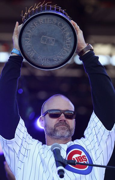 David Ross #3 of the Chicago Cubs holds the World Series trophy during the Chicago Cubs victory celebration in Grant Park on November 4, 2016 in Chicago, Illinois. The Cubs won their first World Series championship in 108 years after defeating the Cleveland Indians 8-7 in Game 7.