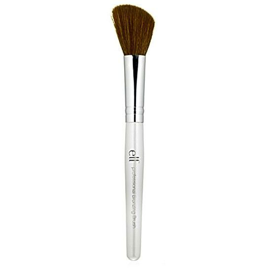 Elf Blushing Bronzing and Blending Brush For Cheeks & Face elf cosmetic ,brushes This unique three-in-one brush allows for precision application of blush, bronzer, and all other multipurpose dusts and loose powders The angled bristles perfectly fit the curves of your cheekbone to expertly define, shape and contour your cheek area NEW AND IMPROVED-NOW WITH SYNTHETIC FIBERS e.l.f. Blush Bronzing Blending Brush This unique three-in-one brush allows for precision application of blush, bronzer...
