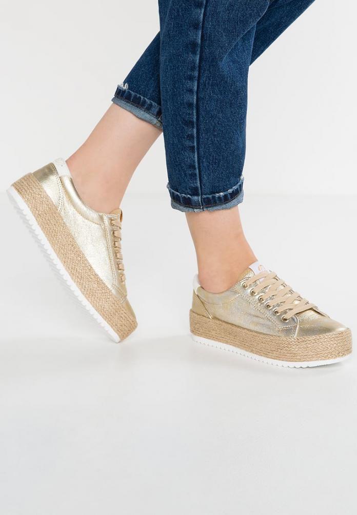 Trend: de zomer aan je voeten met 'sneakerdrilles' - Libelle