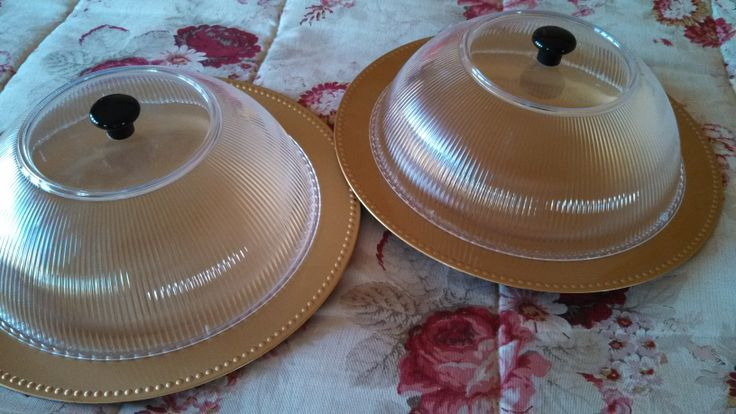 Dollar store clear bowls, glue or screw on a knob.  Use as covers for buffet foods, or outdoor picnics.  I use to cover samples in grocery store.