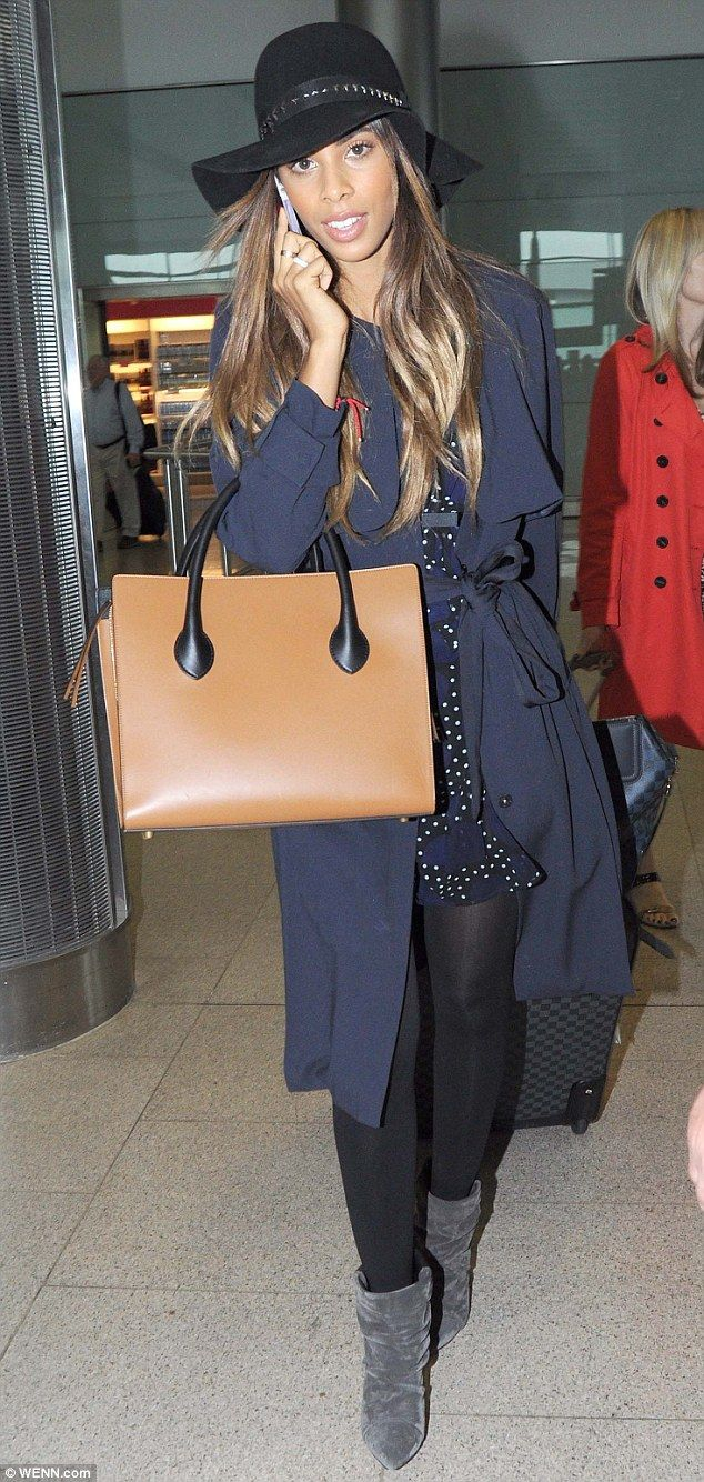 Glamour goddess! Rochelle Humes looked elegant in a blue dress and trenchcoat as she chatt...
