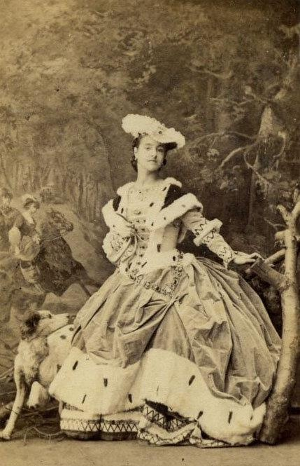 Victorian opera diva Adelina Patti wearing an Ermine trimmed ensemble.