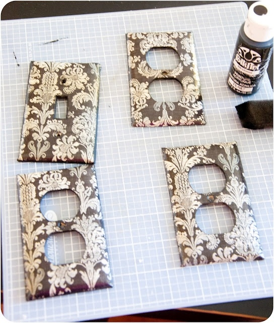 Scrapbook paper and mod podge can change the look of outlet covers and light switch covers