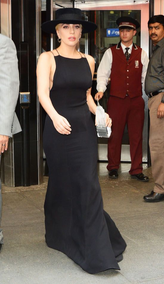 Lady Gaga rocking a long black and sexy dress with a modern hat in NYC this week.