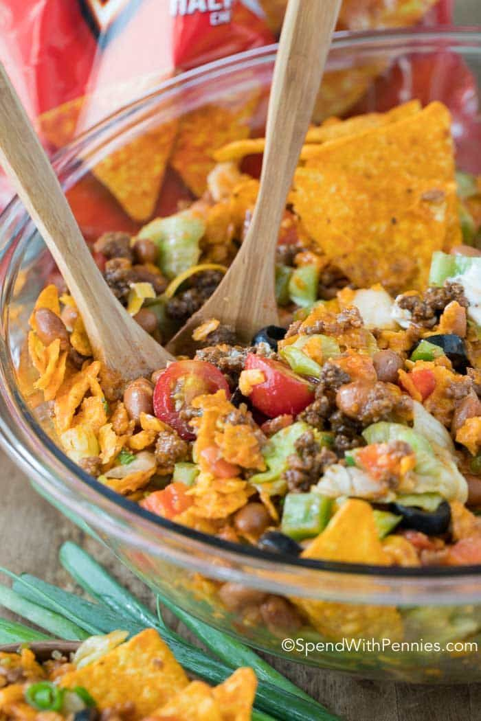 Dorito Taco Salad was the biggest hit at my last party! It's so good with loads of seasoned ground beef, veggies, beans and Doritos in a zesty dressing!
