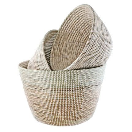"set of 3 for $110 Deep V Nesting Baskets These sturdy deep-v woven baskets are fantastic storage solutions. There are uses galore for this unique basket set throughout the home. Handmade by Wolof women in rural Senegal, each basket serves to generate income to provide food, shelter and educational materials for Senegalese homes. sold as set of 3 large: 17"" d x 12"" t medium: 14"" d x 10"" t small: 11.5""d x 8"" t"