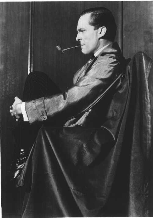 Jeremy Brett as Sherlock Holmes in a pose based on the original sidney paget illustration