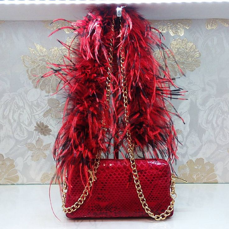 @ritzybagz Python handbag with ostrich feather chain