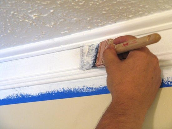 Alternative to crown molding:  quarter-round molding and thin chair rail molding with four inches of white paint on the wall in between.  Genius!