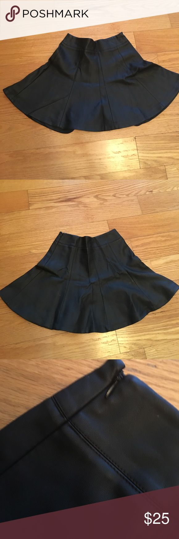 Black Faux Leather Skater Skirt Black faux leather skater skirt. Side zipper entry with clasp. 60% Polyurethane 40% Polyester. Express Skirts Circle & Skater
