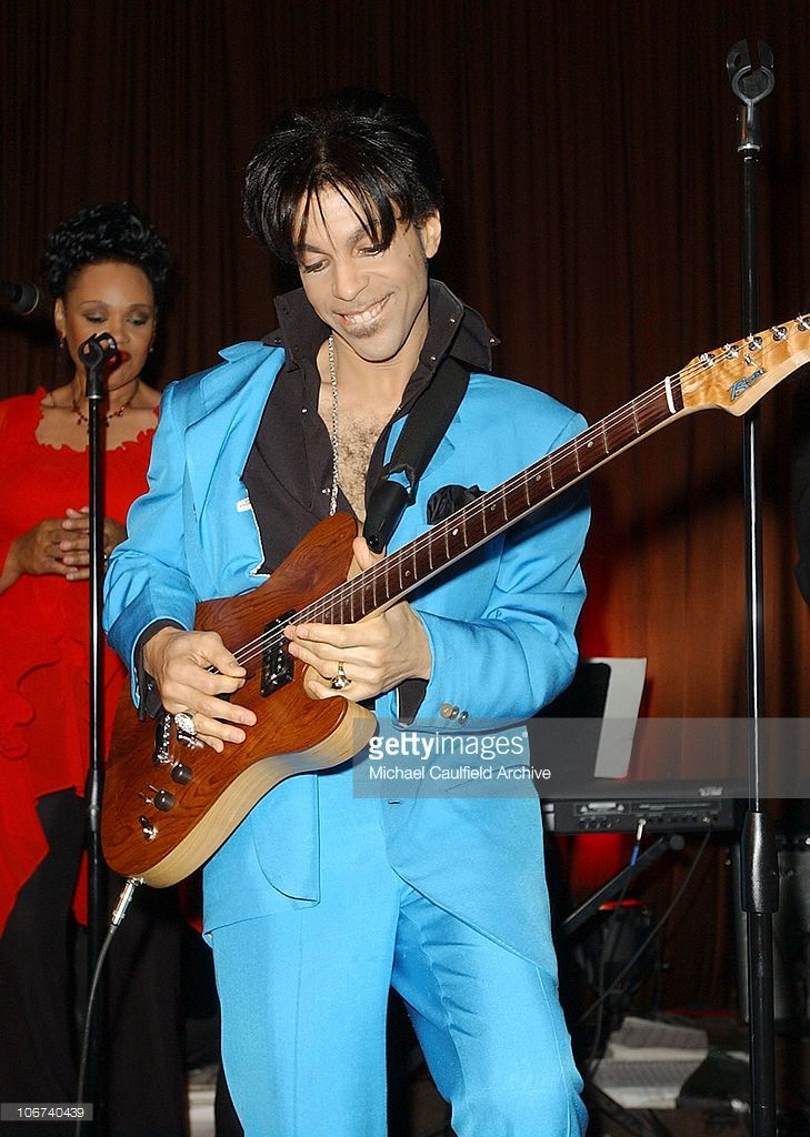 Prince, performing during The 61st Annual Golden Globe Awards - InStyle/ Warner Bros Golden Globe After Party - Inside at Palm Court at the Beverly Hilton in Beverly Hills, California, United States.