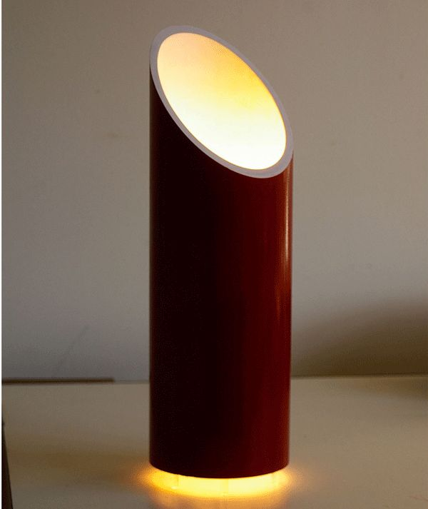 This lamp adds a romantic glow to any room. Designed to provide good airflow around the bulb, it seems to float magically on a soft ring of light around its base.