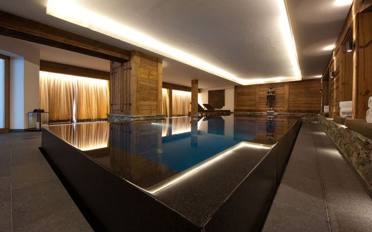 Chalet Dent Blanche - Verbier. Beautiful sunken indoor swimming pool. Available from Firefly Collection. #luxuryskichalet #chaletdentblanche #fireflycollection #stylish #interiordesign