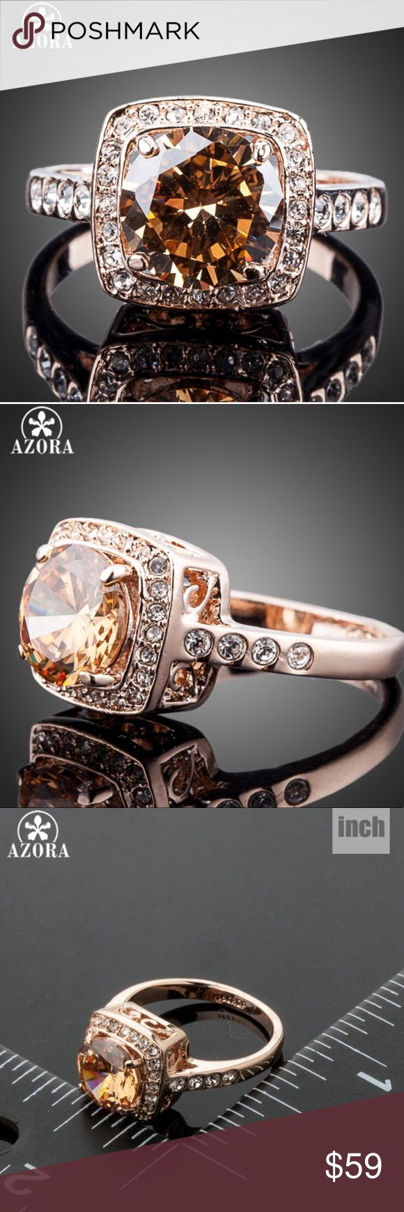 NWT GOLDEN BLISS NWT GOLDEN BLISS IS A GORGEOUS PIECE! SHES A CHAMPAGNE SWAROVSKI ELEMENT AND CLEAR ACCENTS TO COMPLIMENT THE MAIN ELEMENT THIS BEAUTY IS SET IN 18K ROSE GOLD OVER ALLOY MAIN MEASURES APPROX 10 MM X 10MM includes black velvet gift box AZORA Jewelry Rings