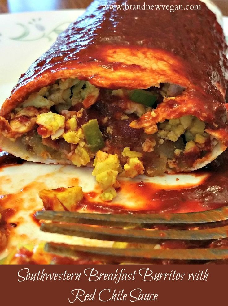 Veganized Breakfast Burritos - New Mexico Style. Southwestern scrambled tofu and potatoes smothered in a rich red chile sauce. My new favorite recipe!