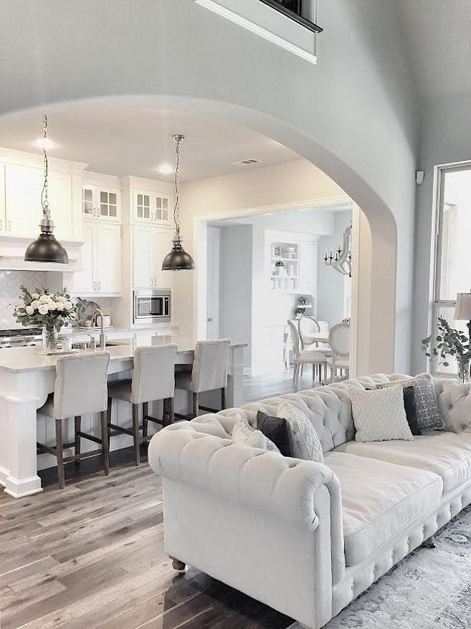 Neutral Farmhouse kitchen with dark hardwood floors…...