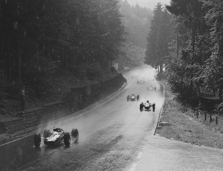 Solitude GP, 1964: Jim Clark in Lotus Climax leads on his way to victory in non-points race. Surtees in a Ferrari finished second. Much of the field failed to finish the first lap due to standing water on the course.