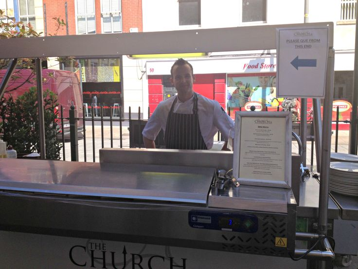 We have the handsome John manning the BBQ today. It's definitely going to be a good day.
