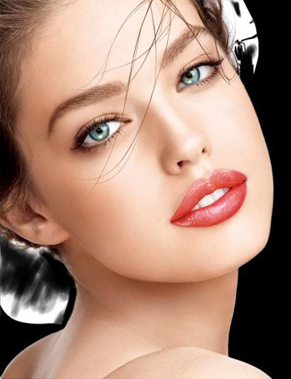 Beautiful, classic face. The makeup was expertly done. Simple, but still dramatic and romantic. :)