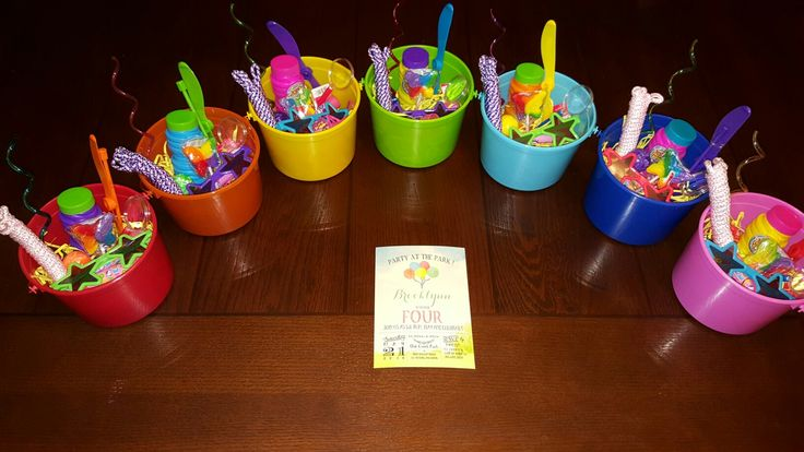 Party favor buckets for playground birthday! Bubbles, sunglasses, jump rope, bouncy ball, magnifying glass, crazy straw, helicopter, rainbow butterfly lollipop