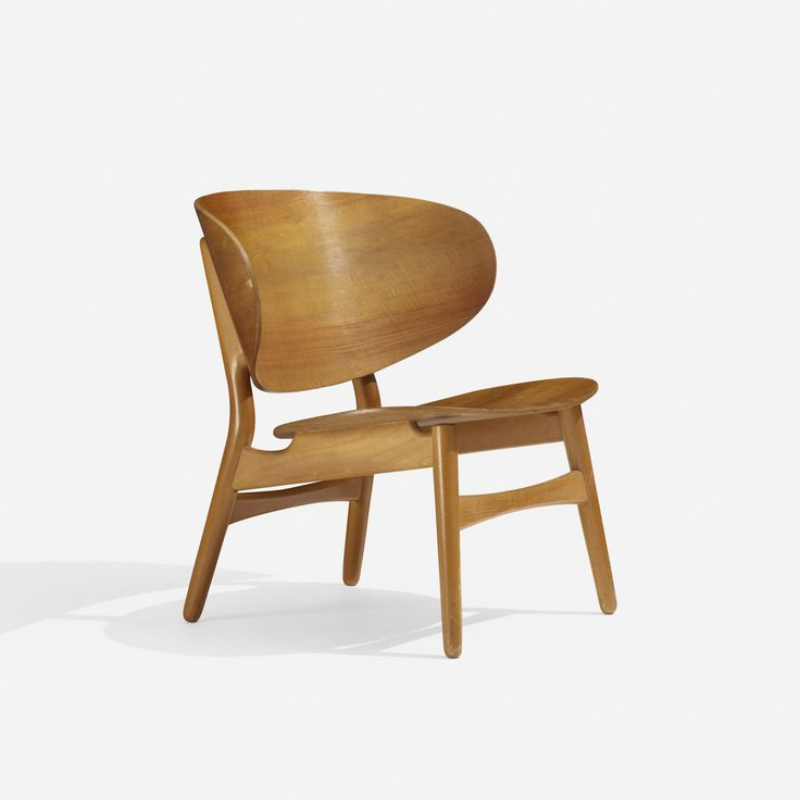 Lot 135: Hans J. Wegner. Shell chair. 1948, teak plywood, stained beech. 27¾ w x 24½ d x 27¾ h in. result: $4,063. estimate: $3,000–5,000. Signed with stamped manufacturer's mark to underside: [FH].
