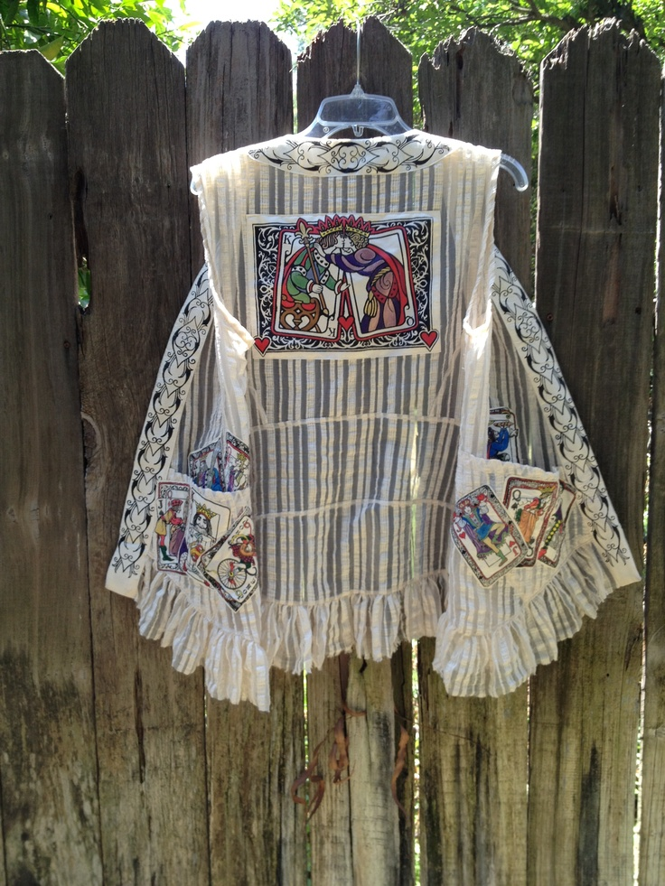 """Vest using Dover clip art by Myrna Elliott.  """"I made silk screens of the playing cards in the Dover Wild Cards Stained Glass Coloring Book, screened them onto fabric, then hand colored them with colored pens.  The cards are appliqued in and around the pockets, as well as on the back."""""""