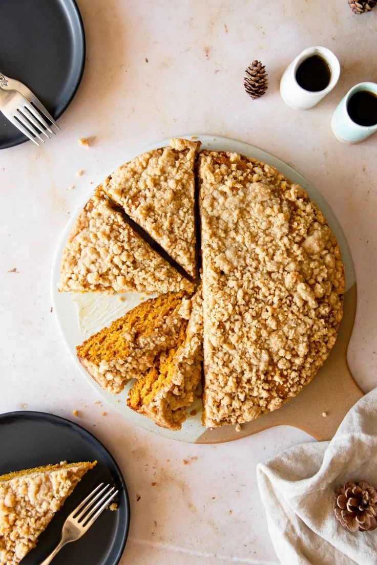 This delicious pumpkin coffee cake consists of a moist and perfectly spiced pumpkin cake layer topped with an easy crumb topping! This pumpkin cake is perfect served with a cup of coffee for a fall breakfast or a snack! #crumbcake #streusel #coffeecake #greekyogurt #thanksgiving #fallrecipes #pumpkinrecipes #pumpkindesserts #breakfast #photography