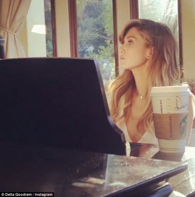Peaceful: Delta Goodrem delighted fans with a short musical session on Saturday as she s...