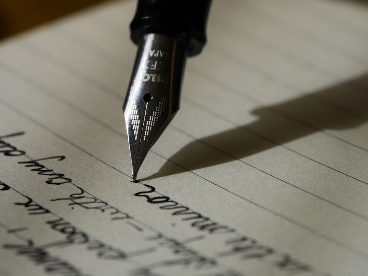 Close-up of a fountain pen writing in a notebook