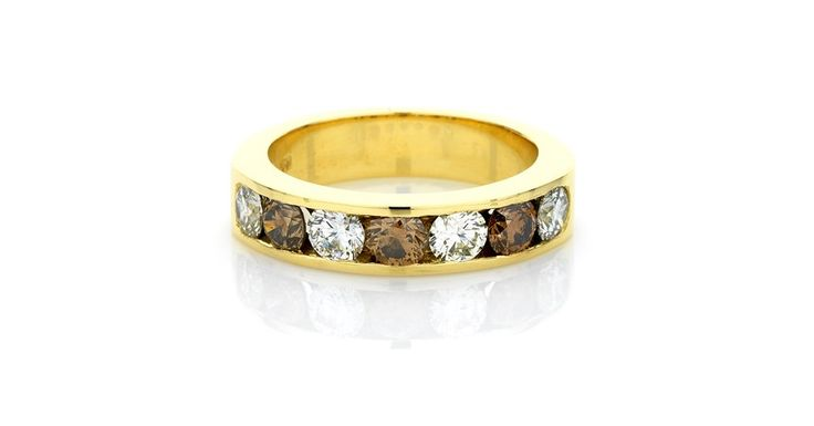 Natural cognac coloured diamonds and white diamond channel set band in 18ct yellow gold