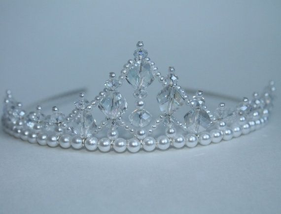 This is the perfect tiara for your little princess or flower girl. The tiara measures 4 cm / 1.75 inches at its highest peak. There are 36
