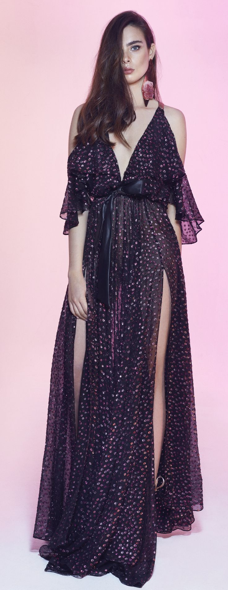 Nobo V: Pink polka dotted see-through black chiffon maxi dress. Deep plunging neckline halter top with off-the-shoulder details. Flowy loose gown with a black belt over the waist accentuating the figure. #RTW #dress