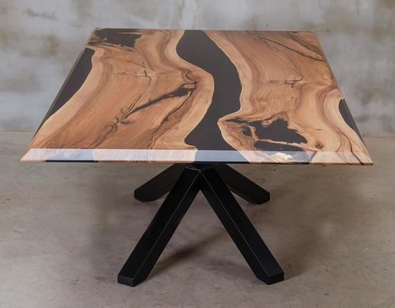 Custom epoxy resin table made of walnut wood and b…