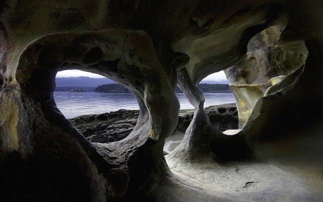 Chrome Island from Hornby Island through the sculptural shapes of Tafoni sandstone via Shanyn Key-Hughes