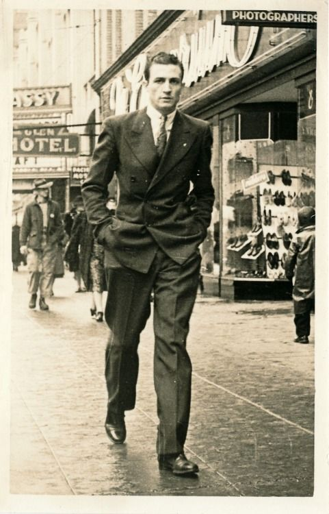 Fashionable young man in a hurry, 1940's suit double breasted pants jacket tie....you are welcome ladies! ;o)