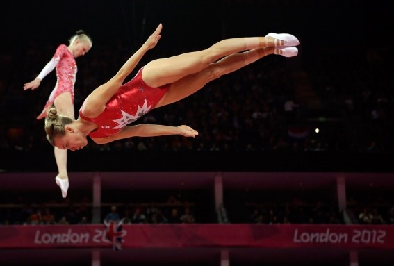 Canada's Karen Cockburn warms up for the women's trampoline finals at the 2012 Summer Olympics, Saturday, Aug. 4, 2012, in London.