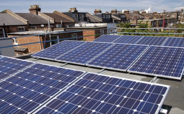 Solar power installations have helped Ipswich Council save almost £100,000.