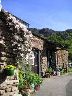 High Wallabarrow Farm, Lake District, Cumbria. Adjoining the farmhouse the accommodation overlooks the garden, beck, rocky crags and the farmyard. The woodlands, garden and vegetable beds are all managed without using chemicals http://www.organicholidays.co.uk/at/1359.htm