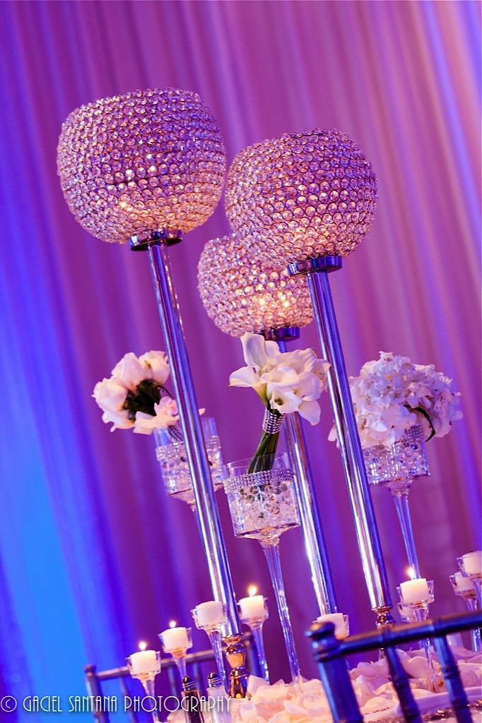 Wow! I love these tall, sparkly candle holders and the tall candle holders with blinged bouquets in them- different but beautiful centerpiece ideas!