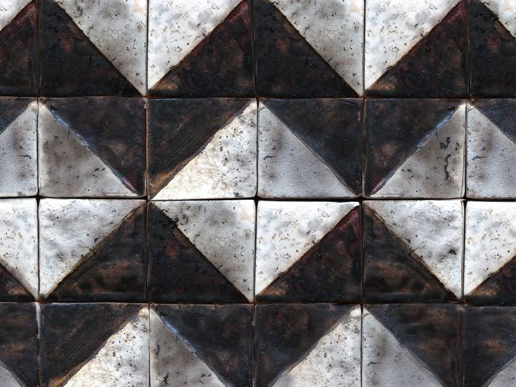 Handmade industrial style square tile mosaic, decorated with black stripes against a white background and fired in a raku kiln.