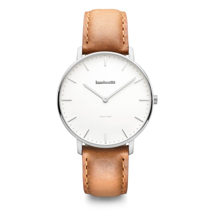 A vintage inspired classic watch. Thin and elegant polished silver case with a white dial, paired with a stylish tanned brown strap made of genuine Italian leather (with smart quick-release pins for easy strap changing). This timepiece will go well with any dressed occasion or for a fashionable and stylish casual look.
