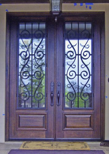 Straight top wood with wrought iron double entry door.