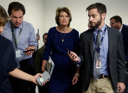 Senator Lisa Murkowski speaks to reporters as she arrives for a vote on Capitol Hill in Washington