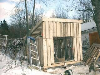 lots of pallet sheds and buildings...they look easy...maybe the way we do it...definitely need to make the woodshed