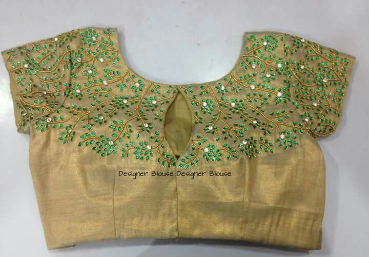 Gold blouse with green embroidery